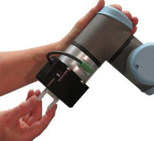 precision electric gripper for UR3e with hand demonstrating teachable fingers