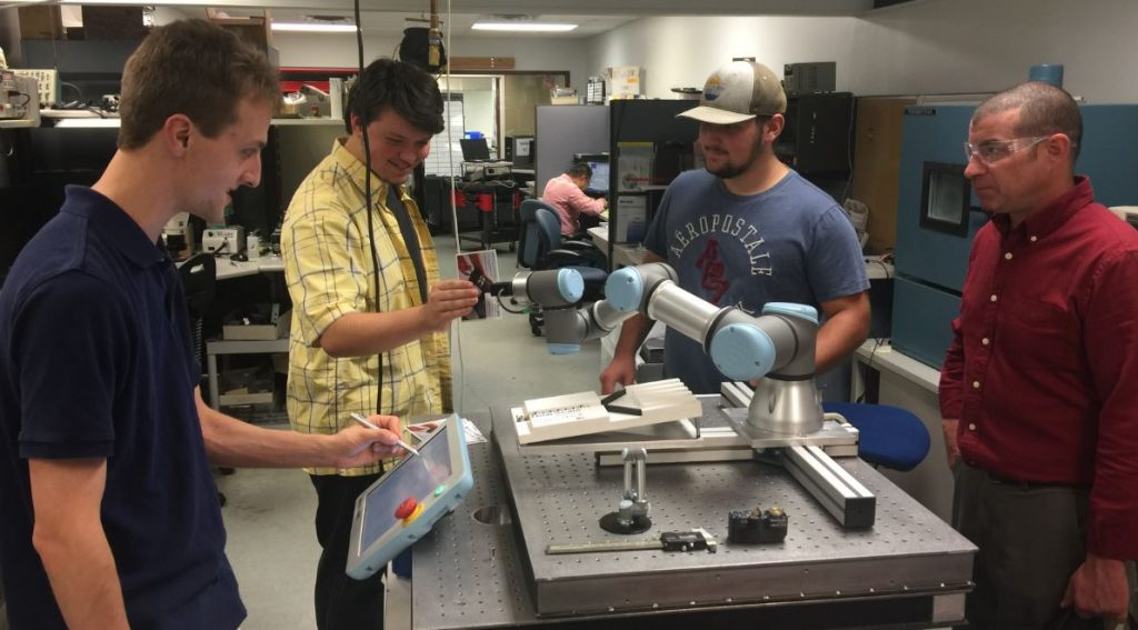 FLCC students learn about cobots at New Scale Robotics lab